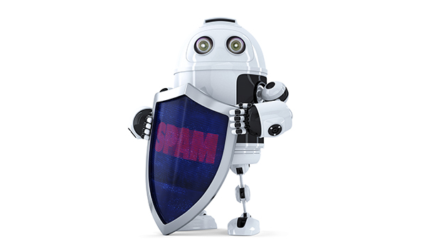 Robot with the shield. Spam protection concept. Isolated over white. Contains clipping path